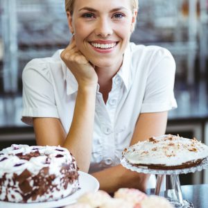 happy-pretty-woman-preparing-plate-of-cake.jpg